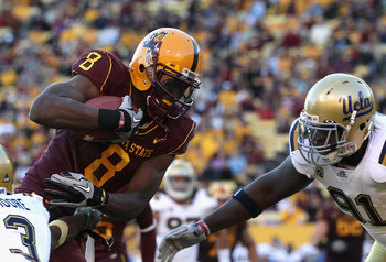 TEMPE, AZ - NOVEMBER 26:  Wide reciever Gerell Robinson #8 of the Arizona State Sun Devils runs with the football after a reception against the UCLA Bruins during the college football game at Sun Devil Stadium on November 26, 2010 in Tempe, Arizona.  The