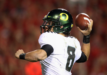 TUCSON, AZ - NOVEMBER 21:  Quarterback Jeremiah Masoli #8 of the Oregon Ducks throws a pass during the college football game against the Arizona Wildcats at Arizona Stadium on November 21, 2009 in Tucson, Arizona. The Ducks defeated the Wildcats 44-41 in