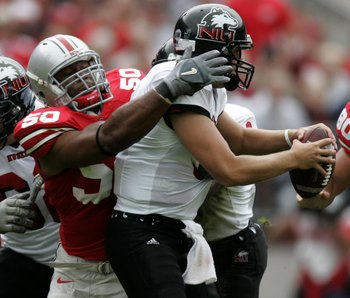 COLUMBUS, OH - SEPTEMBER 02:  Vernon Gholston #50 of the Ohio State Buckeyes sacks Phil Horvath #3 of the Northern Illinois Huskies on September 2, 2006 at Ohio Stadium in Columbus, Ohio. Ohio State won the game 35-12.  (Photo by Gregory Shamus/Getty Imag