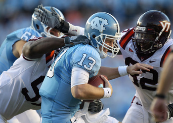 CHAPEL HILL, NC - NOVEMBER 13:  Teammates John Graves #91 and Steven Friday #82 of the Virginia Tech Hokies sack T.J. Yates #13 of the North Carolina Tar Heels during their game at Kenan Stadium on November 13, 2010 in Chapel Hill, North Carolina.  (Photo