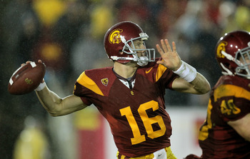 LOS ANGELES - NOVEMBER 27: Quarterback Mitch Mustain #16 of the USC Trojans throws a pass against the Notre Dame Fighting Irish at the Los Angeles Memorial Coliseum on November 27, 2010 in Los Angeles, California.  Notre Dame won 20-16.  (Photo by Stephen
