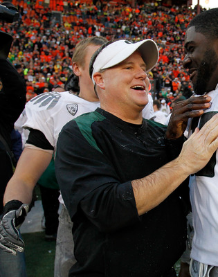 CORVALLIS, OR - DECEMBER 04:  Head Coach Chip Kelly of the Oregon Ducks laughs with Drew Davis #10 after having Gatorade dumped on him after the 37-20 victory over the Oregon State Beavers during the 114th Civil War on December 4, 2010 at the Reser Stadiu