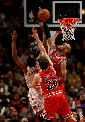 CHICAGO, IL - FEBRUARY 15: Taj Gibson #22 of the Chicago Bulls blocks a shot by Gerald Henderson #15 of the Charlotte Bobcats as Kyle Korver #26 defends at the United Center on February 15, 2011 in Chicago, Illinois. The Bulls defeated the Bobcats 106-94.
