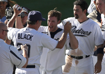 SAN DIEGO, CA - SEPTEMBER 25:  Chris Denorfia #13 of the San Diego Padres is congratulated by Manager Bud Black after hitting the winning RBI  with teammates Chase Headley #7 scoring the winning run during the Padres 4-3 win over the Cincinnati Reds in th