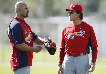 JUPITER, FL - FEBRUARY 17: Albert Pujols #5 #5 of the St. Louis Cardinals talks to Manager Tony La Russa #10 at Roger Dean Stadium on February 17, 2011 in Jupiter, Florida. (Photo by Joel Auerbach/Getty Images)