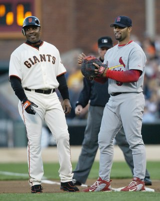 SAN FRANCISCO - MAY 23:   Barry Bonds #25 of the San Francisco Giants talks with Albert Pujols #5 of the St. Louis Cardinals during the game May 23, 2006 at AT&T Park in San Francisco, California.  (Photo by Otto Greule Jr/Getty Images)