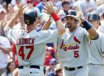 CHICAGO, IL - MAY 30:  Albert Pujols #5 of the St. Louis Cardinals celebrates his fifth inning two run home run against the Chicago Cubs with teammate Ryan Ludwick #47 on May 30, 2010 at Wrigley Field in Chicago, Illinois.  (Photo by Jim McIsaac/Getty Ima