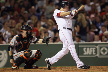 BOSTON - SEPTEMBER 22:  Josh Reddick #46 of the Boston Red Sox hits a solo home run in the fifth inning as Matt Wieters #32 of the Baltimore Orioles defends on September 22, 2010 at Fenway Park in Boston, Massachusetts.  (Photo by Elsa/Getty Images)