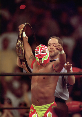 SAN DIEGO - JULY 12:  New cruiserweight champion Rey Mysterio Jr acknowledges the crowd after defeating Jericho during the WWE Bash at the Beach event at Cox Arena in San Diego, California on July 12, 1998.  (Photo by Elsa /Getty Images)