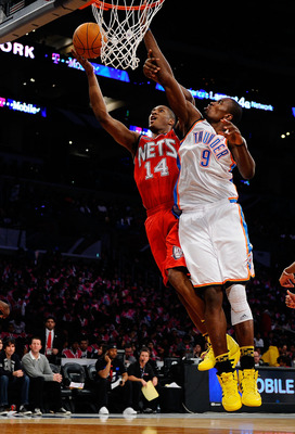LOS ANGELES, CA - FEBRUARY 18:  Derrick Favors #14 of the New Jersey Nets and the Rookie Team goes up for a shot against Serge Ibaka #9 of the Oklahoma City Thunder and the Sophomore Team in the second half during the T-Mobile Rookie Challenge and Youth J