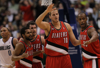 DALLAS, TX - DECEMBER 15:  (L-R) Patrick Mills #8, Rudy Fernandez #4, Joel Przybilla #10 and Dante Cunningham #33 of the Portland Trail Blazers at American Airlines Center on December 15, 2010 in Dallas, Texas.  NOTE TO USER: User expressly acknowledges a