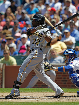 CHICAGO - JUNE 30: Andrew McCutchen #22 of the Pittsburgh Pirates hits the ball against the Chicago Cubs at Wrigley Field on June 30, 2010 in Chicago, Illinois. The Pirates defeated the Cubs 2-0. (Photo by Jonathan Daniel/Getty Images)