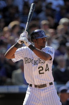 DENVER - APRIL 09:  Dexter Fowler #24 of the Colorado Rockies takes an at bat against the San Diego Padres during MLB action on Opening Day at Coors Field on April 9, 2010 in Denver, Colorado. The Rockies defeated the Padres 7-0.  (Photo by Doug Pensinger