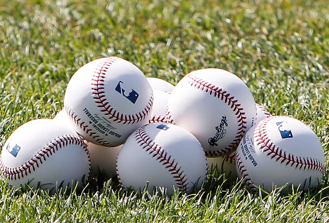 SARASOTA, FL - APRIL 03:  Spring Training baseballs sit on the field prior to the start of the Grapefruit League Spring Training Game between the Baltimore Orioles and the New York Mets at Ed Smith Stadium on April 3, 2010 in Sarasota, Florida.  (Photo by