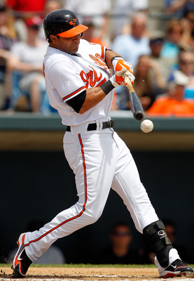 SARASOTA, FL - APRIL 03:  Infielder Brian Roberts #1 of the Baltimore Orioles fouls off a pitch against the New York Mets during a Grapefruit League Spring Training Game at Ed Smith Stadium on April 3, 2010 in Sarasota, Florida.  (Photo by J. Meric/Getty