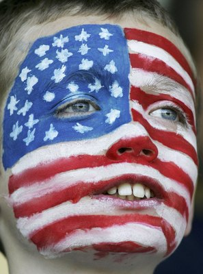 NORDERSTEDT, GERMANY - JUNE 06:  A young USA fan watches during a training session for the United States National Team on June 6, 2006 at Edmund Plambeck Stadium in Norderstedt, Germany.  (Photo by Jonathan Ferrey/Getty Images)