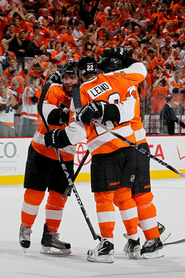 PHILADELPHIA - MAY 24:  Mike Richards #18 and Ville Leino #22 of the Philadelphia Flyers celebrate after defeating the Montreal Canadiens by a score of 4-2 to win Game 5 of the Eastern Conference Finals and to advance to the 2010 NHL Stanley Cup Finals at