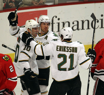 CHICAGO, IL - JANUARY 05: (L-R) Brenden Morrow #10, Brad Richards #91 and Loui Eriksson #21 of the Dallas Stars celebrate Morrows' 1st period goal as Duncan Kieth #2 and Jonathan Toews #19 of the Chicago Blackhawks skate away at the United Center on Janua