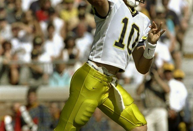 5 Sep 1998:  Quarterback Tom Brady #10 of the Michigan Wolverines throws a pass during a game against the Notre Dame Fighting Irish at the Notre Dame Stadium in South Bend, Indiana. The Fighting Irish defeated the Wolverines 36-20.