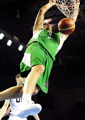 AUCKLAND, NEW ZEALAND - JULY 08:  Tautvydas Slezas of Lithuania dunks the ball during the U19 Basketball World Championships match between the United States and Lithuania at North Shore Events Centre on July 8, 2009 in Auckland, New Zealand.  (Photo by Ha