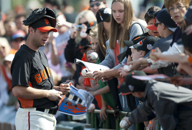 SCOTTSDALE, AZ - FEBRUARY 25: Brandon Belt #9 of the San Francisco Giants signs autographs before a spring training game against the Arizona Diamondbacks at Scottsdale Stadium on February 25, 2011 in Scottsdale, Arizona. (Photo by Rob Tringali/Getty Image