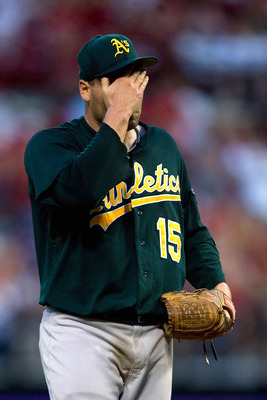 ST. LOUIS - JUNE 19: Starting pitcher Ben Sheets #15 of the Oakland Athletics reacts after giving up a two-run home run against the St. Louis Cardinals at Busch Stadium on June 19, 2010 in St. Louis, Missouri.  The Cardinals beat the Athletics 4-3.  (Phot