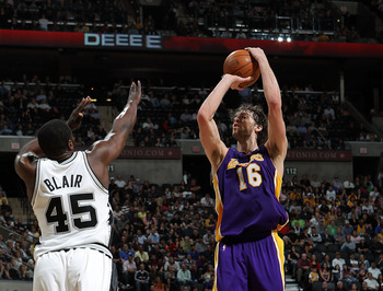 SAN ANTONIO - MARCH 24: Forward Pau Gasol #16 of the Los Angeles Lakers takes a shot against DeJuan Blair #45 of the San Antonio Spurs at AT&T Center on March 24, 2010 in San Antonio, Texas. NOTE TO USER: User expressly acknowledges and agrees that, by do