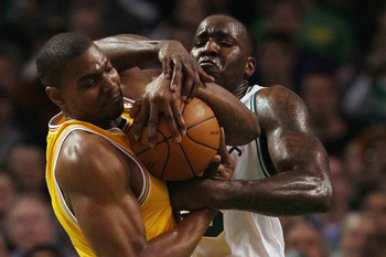BOSTON, MA - FEBRUARY 10:  Kendrick Perkins #43 of the Boston Celtics and Andrew Bynum #17 of the Los Angeles Lakers fight for the ball in the first quarter against on February 10, 2011 at the TD Garden in Boston, Massachusetts.  NOTE TO USER: User expres