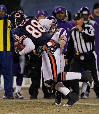 CHICAGO - DECEMBER 28: Desmond Clark #88 of the Chicago Bears tries to break away from Chad Greenway #52 of the Minnesota Vikings at Soldier Field on December 28, 2009 in Chicago, Illinois. The Bears defeated the Vikings 36-30 in overtime. (Photo by Jonat