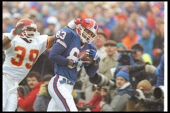 23 Jan 1994:  Wide receiver Andre Reed of the Buffalo Bills catches the ball as Kansas City Chiefs defensive back Bruce Pickens covers him during a playoff game at Rich Stadium in Orchard Park, New York.  The Bills won the game, 30-13. Mandatory Credit: R
