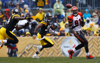 PITTSBURGH - DECEMBER 12:  Terell Owens #81 of the Cincinnati Bengals catches a pass in front of Ryan Clark #25 of the Pittsburgh Steelers during the game on December 12, 2010 at Heinz Field in Pittsburgh, Pennsylvania.  (Photo by Jared Wickerham/Getty Im