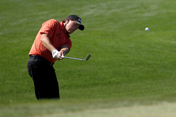 MARANA, AZ - FEBRUARY 24:  Phil Mickelson hits an approach shot on the 13th hole during the second round of the Accenture Match Play Championship at the Ritz-Carlton Golf Club on February 24, 2011 in Marana, Arizona.  (Photo by Andy Lyons/Getty Images)