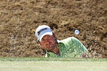 MARANA, AZ - FEBRUARY 25:  Graeme McDowell of Northern Ireland hits from a bunker on the second hole during the third round of the Accenture Match Play Championship at the Ritz-Carlton Golf Club on February 25, 2011 in Marana, Arizona.  (Photo by Andy Lyo