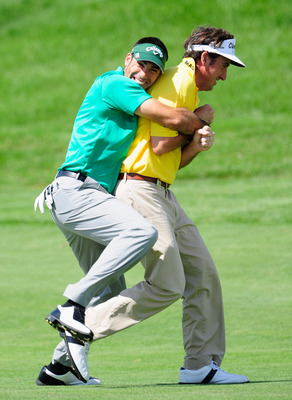MADRID, SPAIN - MAY 28:  Alvaro Quiros holds onto playing partner and country man Gonzalo Fernandez - Castano of Spain during the second round of the Madrid Masters at Real Sociedad Hipica Espanola Club De Campo on May 28, 2010 in Madrid, Spain.  (Photo b