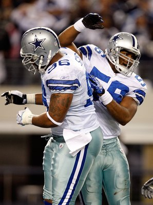 ARLINGTON, TX - JANUARY 9:  Linebacker Bradie James #56 and Marcus Spears #96 of the Dallas Cowboys during the 2010 NFC wild-card playoff game at Cowboys Stadium on January 9, 2010 in Arlington, Texas. (Photo by Ronald Martinez/Getty Images)