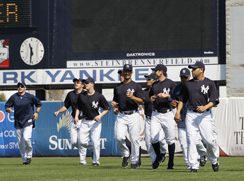 TAMPA, FL - FEBRUARY 20:  The New York Yankees warm up prior to the start of the first full team workout of Spring Training on February 20, 2011 at the George M. Steinbrenner Field in Tampa, Florida.  (Photo by Leon Halip/Getty Images)