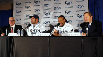 ST PETERSBURG, FL - FEBRUARY 01:  (L to R)  Tampa Bay Rays manager Joe Maddon, Johnny Damon #22 and Manny Ramirez #24 of the Tampa Bay Rays, and agent Scott Boras talk with reporters during a press conference at Tropicana Field on February 1, 2011 in St P