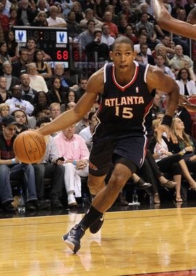 MIAMI, FL - DECEMBER 04:  Al Horford #15 of the Atlanta Hawks drives to the basket during a game against the Miami Heat at American Airlines Arena on December 4, 2010 in Miami, Florida. NOTE TO USER: User expressly acknowledges and agrees that, by downloa