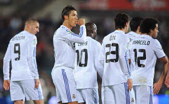 GETAFE, SPAIN - JANUARY 03:  Cristiano Ronaldo (2nd L) of Real Madrid celebrates after scoring Real's first goal from the penalty spot during the La Liga match between Getafe and Real Madrid at Coliseum Alfonso Perez stadium on January 3, 2011 in Getafe,