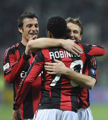 MILAN, ITALY - FEBRUARY 12:  Robinho (#70) of Milan celebrates with team mates after scoring his team's goal during the Serie A match between AC Milan and Parma FC at Stadio Giuseppe Meazza on February 12, 2011 in Milan, Italy.  (Photo by Dino Panato/Gett