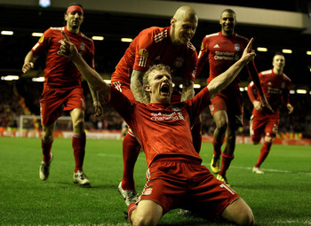 LIVERPOOL, ENGLAND - FEBRUARY 24:  Dirk Kuyt of Liverpool celebrates scoring the first goal during the UEFA Europa League Round of 32 2nd leg match beteween Liverpool and Sparta Prague at Anfield on February 24, 2011 in Liverpool, England.  (Photo by Rich