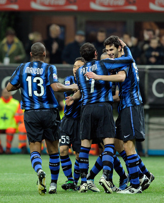MILAN, ITALY - FEBRUARY 19:  FC Internazionale Milano players celebrate the first goal during the Serie A match between FC Internazionale Milano and Cagliari Calcio at Stadio Giuseppe Meazza on February 19, 2011 in Milan, Italy.  (Photo by Claudio Villa/G