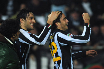 TURIN, ITALY - FEBRUARY 13:  Alessandro Matri (R) of Juventus FC celebrates scoring the opening goal with team mate Luca Toni during the Serie A match between Juventus FC and FC Internazionale Milano at Olimpico Stadium on February 13, 2011 in Turin, Ital