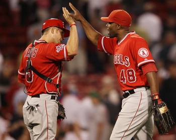 BOSTON - AUGUST 19:  Torii Hunter #48 and Jeff Mathis #5 of the Los Angeles Angels of Anaheim celebrate the win over the Boston Red Sox on August 19, 2010 at Fenway Park in Boston, Massachusetts. The Angels defeated the Red Sox 7-2.  (Photo by Elsa/Getty