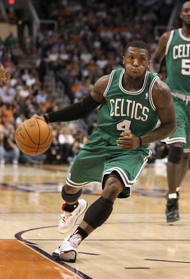 PHOENIX, AZ - JANUARY 28:  Nate Robinson #4 of the Boston Celtics handles the ball during the NBA game against the Phoenix Suns at US Airways Center on January 28, 2011 in Phoenix, Arizona. The Suns defeated the Celtics 88-71. NOTE TO USER: User expressly
