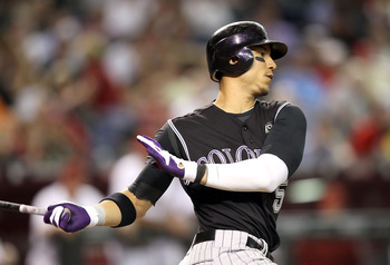 PHOENIX - SEPTEMBER 21:  Carlos Gonzalez #5 of the Colorado Rockies bats against the Arizona Diamondbacks during the Major League Baseball game at Chase Field on September 21, 2010 in Phoenix, Arizona.  (Photo by Christian Petersen/Getty Images)