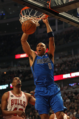 CHICAGO, IL - JANUARY 20: Shawn Marion #0 of the Dallas Mavericks dunks the ball over Kurt Thomas #40 of the Chicago Bulls at the United Center on January 20, 2011 in Chicago, Illinois. The Bulls defeated the Mavericks 82-77. NOTE TO USER: User expressly