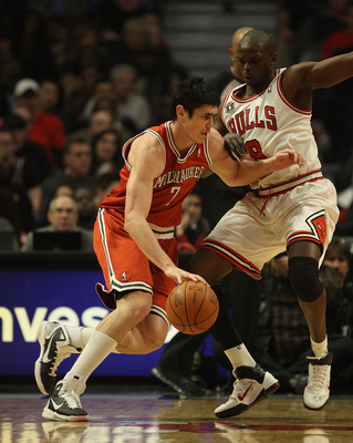 CHICAGO, IL - DECEMBER 28: Ersan Ilyasova #7 of the Milwaukee Bucks moves against Loul Deng #9 of the Chicago Bulls at the United Center on December 28, 2010 in Chicago, Illinois. The Bulls defeated the Bucks 90-77. NOTE TO USER: User expressly acknowledg