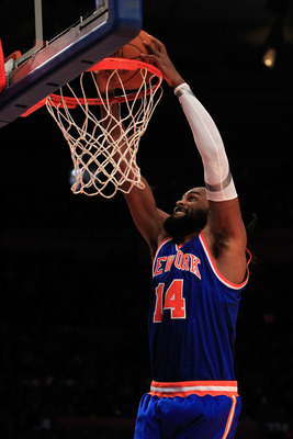 NEW YORK, NY - FEBRUARY 23: Ronny Turiaf #14 of the New York Knicks dunks the ball against the Milwaukee Bucks at Madison Square Garden on February 23, 2011 in New York City. NOTE TO USER: User expressly acknowledges and agrees that, by downloading and/or