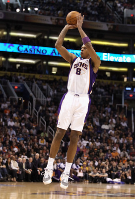 PHOENIX, AZ - JANUARY 05:  Channing Frye #8 of the Phoenix Suns puts up a shot during the NBA game against the Los Angeles Lakers at US Airways Center on January 5, 2011 in Phoenix, Arizona. The Lakers defeated the Suns 99-95.  NOTE TO USER: User expressl